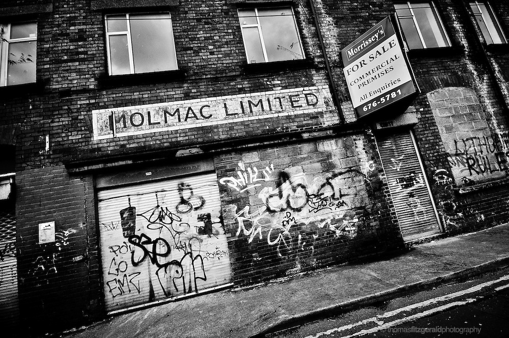 An abandoned Building in Dublin City is rich with texture, from the peeling paint, to the brick work and graffiti