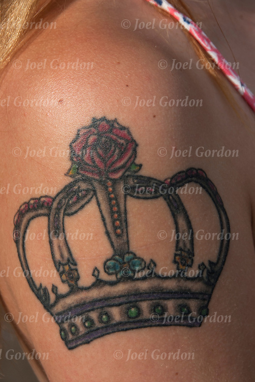Tattoo of rose on top of crown<br />