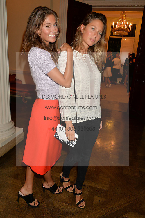 Left to right, sisters QUENTIN JONES and JEMIMA JONES at a party hosed by the US Ambassador to the UK Matthew Barzun, his wife Brooke Barzun and editor of UK Vogue Alexandra Shulman in association with J Crew to celebrate London Fashion Week held at Winfield House, Regent's Park, London on 16th September 2014.