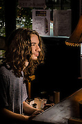 Chick Mossbrucker on keys backing Earl Arnold's performance at The Bus Stop Music Cafe.