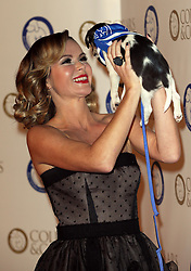 Amanda Holden with Bill an 11 week old Chihuahua puppy at the Collars & Coats Gala Ball in London, Thursday, 7th November 2013. Picture by Stephen Lock / i-Images