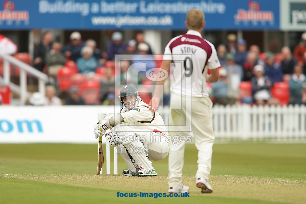 Clint McKay of Leicestershire County Cricket Club ducks under a high delivery from bowler Olly Stone of Northamptonshire County Cricket Club (right) during the LV County Championship Div Two match at Grace Road, Leicester<br /> Picture by Andy Kearns/Focus Images Ltd 0781 864 4264<br /> 27/04/2015
