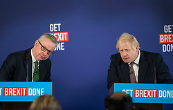 © Licensed to London News Pictures. 29/11/2019. London, UK. Prime Minister Boris Johnson and Michael Gove listen to questions at a press conference in London. Later a seven way TV election debate will take place with senior politicians in Cardiff. Photo credit: Peter Macdiarmid/LNP