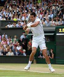 © Licensed to London News Pictures. 6th July 2014. London. UK. Novak Djokovic. Crowds and celebrities watch the The Men's Final between Roger Federer, SUI v Novak Djokovic, SER at the Wimbledon Tennis Championships 2014. Photo credit :  Mike King/LNP