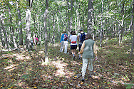 Warwick, New York - Hikers walk through the woods at Fuller Mountain Preserve as part of the 2012 Hudson River Valley Ramble on Sept. 15, 2012. The preserve is owned and managed by the Orange County Land Trust.