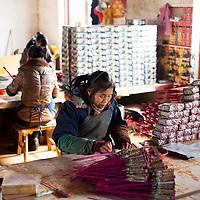 Hunan, Liuyang, Dec. 19..2013 : Hu Yuelan, a worker, assembles  fireckrackers for the Western market in a factory .