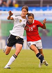 16.06.2011, Bruchwegstadion, Mainz, FIFA WOMENS WORLDCUP 2011, Deutschland (GER) vs. Norwegen (NOR), im Bild  Merstin Garefrekes (Deutschland #18, Frankfurt) im Zweikampf mit Guro Knutsen Mienna (Norwegen, Roa IL) waehrend eines Vorbereitungsspiels // during a friendly match on 2011/06/16, Bruchwegstadion, Mainz, Germany. + EXPA Pictures © 2011, PhotoCredit: EXPA/ nph/  Roth       ****** out of GER / SWE / CRO  / BEL ******