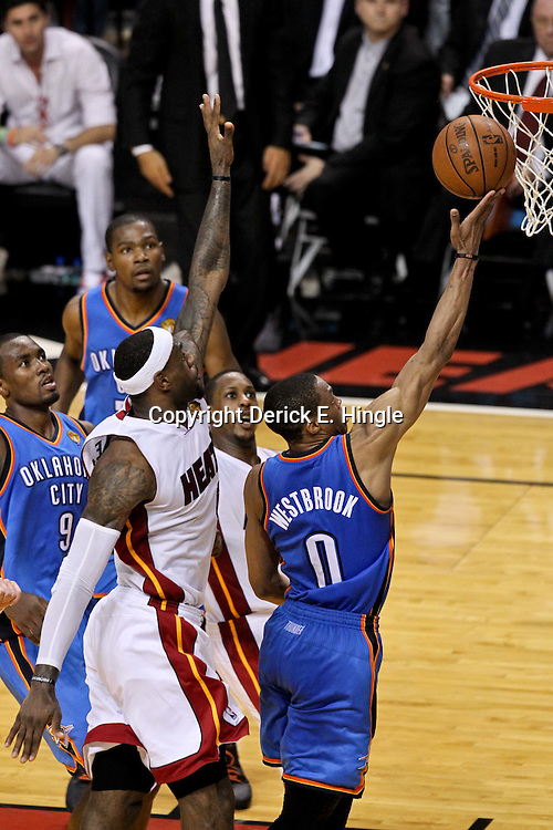Jun 21, 2012; Miami, FL, USA; Oklahoma City Thunder point guard Russell Westbrook (0) shoots over Miami Heat small forward LeBron James (6) during the third quarter in game five in the 2012 NBA Finals at the American Airlines Arena. Mandatory Credit: Derick E. Hingle-US PRESSWIRE