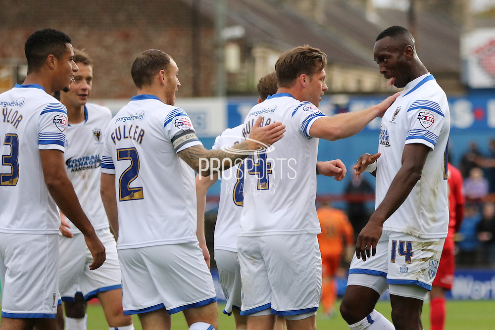 Ade Azeez of AFC Wimbledon celebrates with AFC Wimbledon after his opener during the Sky Bet League 2 match between York City and AFC Wimbledon at Bootham Crescent, York, England on 24 October 2015. Photo by Stuart Butcher.