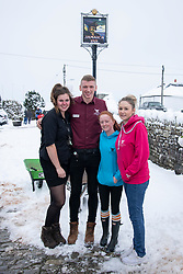 © Licensed to London News Pictures Ltd.. 01/02/2019. Bodmin Moor, UK. The staff of Jamaica Inn stayed awake all night looking after stranded motorists. Snow in Cornwall. L to R April Dawe, David Baillie,  Charlotte Baron, Kate Smith. Motorists on the A30 on Bodmin Moor, who were stranded last night by heavy snowfall. Photo credit: Mark Hemsworth/LNP