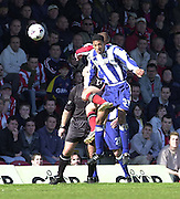 .Photo Peter Spurrier.06/04/2002.Nationwide Div 2.Brentford vs Huddersfield - Griffen Park:.Huddersfield's Dwanye Mattis out jumps Martin Rowlands...