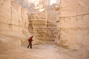 Israel, Judaean Desert, a hiker in Wadi Pratzim, The flash floods carve a deep canyon in the soft chalk sedimentary rock