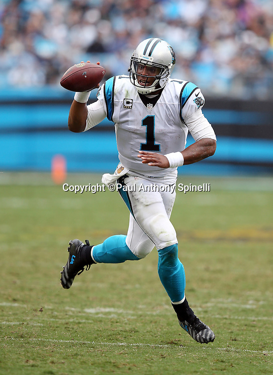 Carolina Panthers quarterback Cam Newton (1) runs a keeper for a 13 yard touchdown and a 27-16 fourth quarter Panthers lead during the 2015 NFL week 3 regular season football game against the New Orleans Saints on Sunday, Sept. 27, 2015 in Charlotte, N.C. The Panthers won the game 27-22. (©Paul Anthony Spinelli)