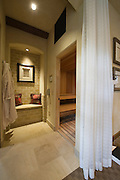 Curtained sauna and steam room in Palm Springs home