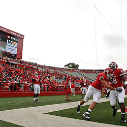 Sep 12, 2009; Piscataway, NJ, USA;  Rutgers defensive end Alex Silvestro (45) and linebacker Marcus Witherspoon (58) warm up before Rutgers' 45-7 victory over Howard in NCAA College Football at Rutgers Stadium.