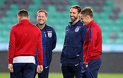 England interim manager Gareth Southgate smiles with Jamie Vardy and Wayne Rooney of England on arrival at the SRC Stozice ahead of the World Cup Qualifier against Slovenia - Mandatory by-line: Robbie Stephenson/JMP - 10/10/2016 - FOOTBALL - SRC Stozice - Ljubljana, England - England Press Conference