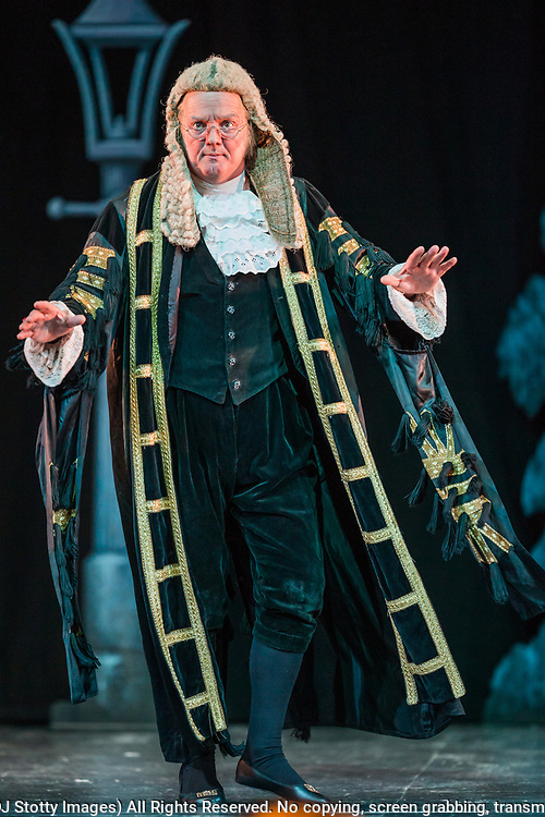 Richard Gauntlett as the Lord Chancellor<br /> <br /> Dress rehearsal of Iolanthe performed by the National Gilbert & Sullivan Opera Company during the <br /> 25th International Gilbert & Sullivan Festival at the Royal Hall Harrogate, North Yorkshire, England on Saturday 18 August 2018 Photo: Jane Stokes<br /> <br /> Director: Cav Vivian Coates<br /> Conductor: James Hendry<br /> Choreographer: Mary MacDonagh<br /> <br /> THE LORD CHANCELLOR/ Richard Gauntlett<br /> EARL OF MOUNTARARAT/Eddie Wade<br /> EARL TOLLOLLER/ Nick Sales<br /> PRIVATE WILLIS/ Matthew Siveter<br /> STREPHON/ Bradley Travis<br /> QUEEN OF THE FAIRIES/Gaynor Keeble<br /> IOLANTHE/Jennifer Parker<br /> CELIA/Stephanie Poropat<br /> LEILA/ Emma Watkinson<br /> FLETA/Alexandra Hazard<br /> PHYLLIS/Rosanna Harris<br /> <br /> THE CHORUS<br /> <br /> Hannah Boxall, Nicole Boardman, Rhiannon Doogan, Joanna Goldspink, Maisy Hepburn, Juliet Montgomery, Julie Power, Eloise Waterhouse<br /> <br /> Andrew Brown, Tom Blackwell, Peter Brooks, Stephen Fawell, Stephen Godward, Matthew Kellett, Michael Vincent Jones, Henry Smith, Jonathan Stevens, Tim Southgate<br /> <br /> TOUR MANAGER/Neil Smith<br /> STAGE MANAGER/Sarah Kent<br /> ASSISTANT STAGE MANAGER/Claire Litton<br /> LIGHTING DESIGN/David Marsden<br /> WARDROBE SUPERVISOR/ Harriet Ravdin<br /> SET DESIGN/ Paul Lazell