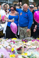 © Licensed to London News Pictures . 25/05/2017 . Manchester , UK . Mother and father of of bombing victim Olivia Campbell , CHARLOTTE CAMPBELL and PAUL HODGSON attend a scooter-led rally to lay flowers at St Ann's Square in Central Manchester , following a terrorist attack at an Ariana Grande concert at Manchester Arena that killed twenty two people . Photo credit : Joel Goodman/LNP