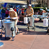 Trash Can Band in Future World at Epcot in Orlando, Florida<br /> One of the delights of visiting Epcot is the seemingly spontaneous performances of music. Almost every country pavilion sponsors one or more acts. Other musicians like this trash can band in Future World simply appear, get things rolling with their percussion talents and immediately attract a crowd. These boys are guaranteed to make your tired feet start tapping to the beat.