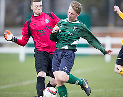 Edinburgh City&rsquo;s Andrew Stobie and Edinburgh University&rsquo;s David Oswald.<br /> Half time : Edinburgh University 0 v 1 Edinburgh City, Scottish Sun Lowland League game played 14/3/2015 at The University of Edinburgh&rsquo;s Peffermill playing field.