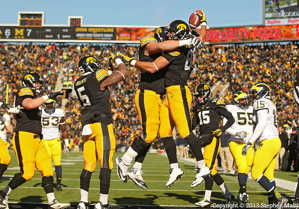 November 23 2013: Iowa Hawkeyes offensive linesman Brandon Scherff (68) and Iowa Hawkeyes tight end C.J. Fiedorowicz (86) celebrate after Fiedorowicz's 5 yard touchdown reception during the first quarter of the NCAA football game between the Michigan Wolverines and the Iowa Hawkeyes at Kinnick Stadium in Iowa City, Iowa on November 23, 2013. Iowa defeated Michigan 24-21.