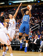 Sep 11, 2011; Phoenix, AZ, USA; Minnesota Lynx guard Seimone Augustus (33) puts up a shot against the Phoenix Mercury guard Diana Taurasi (3) during the first half at the US Airways Center.  The Lynx defeated the Mercury 96-90. Mandatory Credit: Jennifer Stewart-US PRESSWIRE