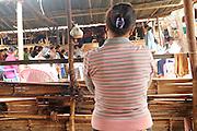 Kachin refugee housewives ai Je Yang Hka near China Myanmar boarder Lai Za. A refugee mother listing health knowledge sharing.