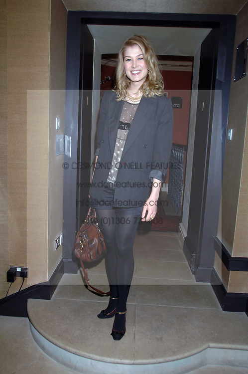 Actress ROSAMUND PIKE at a lunch hosted by Ralph Lauren to present their Spring 2007 collection in support of the Serpentine Gallery's Education Programme, held at Fifty, 50 St.James's Street, London SW1 on 20th March 2007.<br />