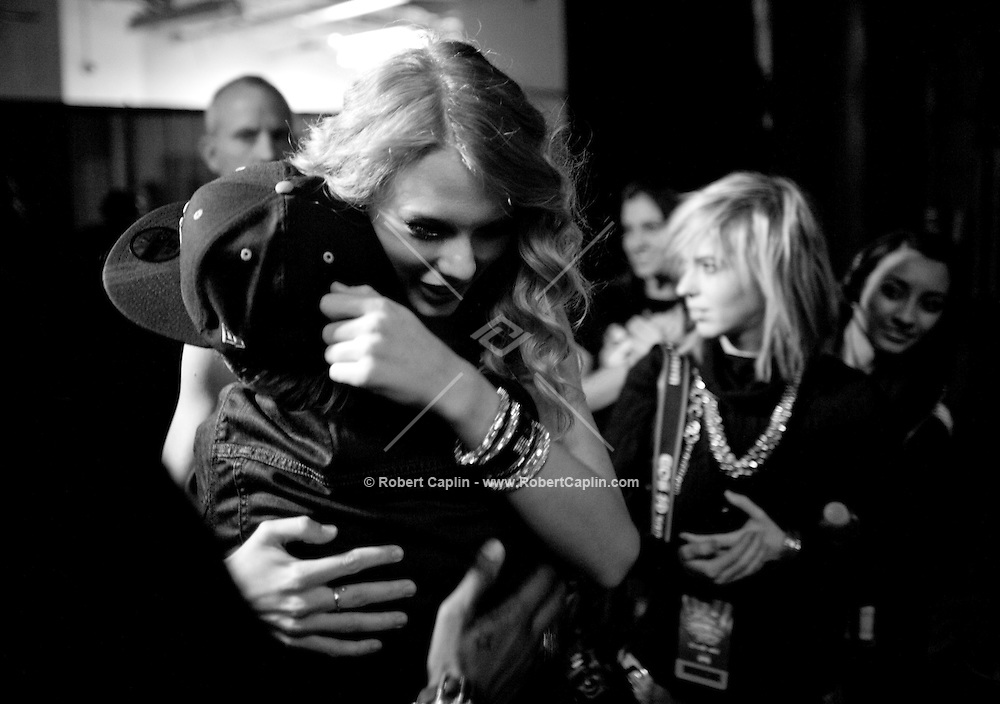 Taylor Swift hugs Justin Bieber backstage at the 2009 Z100's Jingle Ball at Madison Square Garden in New York. It was Bieber's first performance at The Garden. ..(Photo by Robert Caplin)..