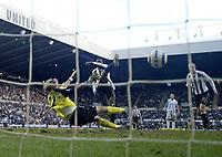 Photo: Andrew Unwin.<br />Newcastle United v Bolton Wanderers. The Barclays Premiership. 04/03/2006.<br />Newcastle's Shola Ameobi (C) scores his team's third goal.