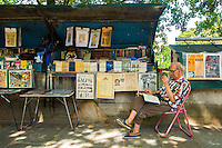 Paris, France - July 17, 2014: Bouquinistes along Seine have been officially selling antique books, journals and other collectibles since 1859. The booksellers present their inventory in green boxes which they open at sunrise and close at dusk. The 3 three-kilometer strech of the Seine where the boxes are installed has been declared a UNESCO World Heritage site.CREDIT: Chris Carmichael for The New York Times