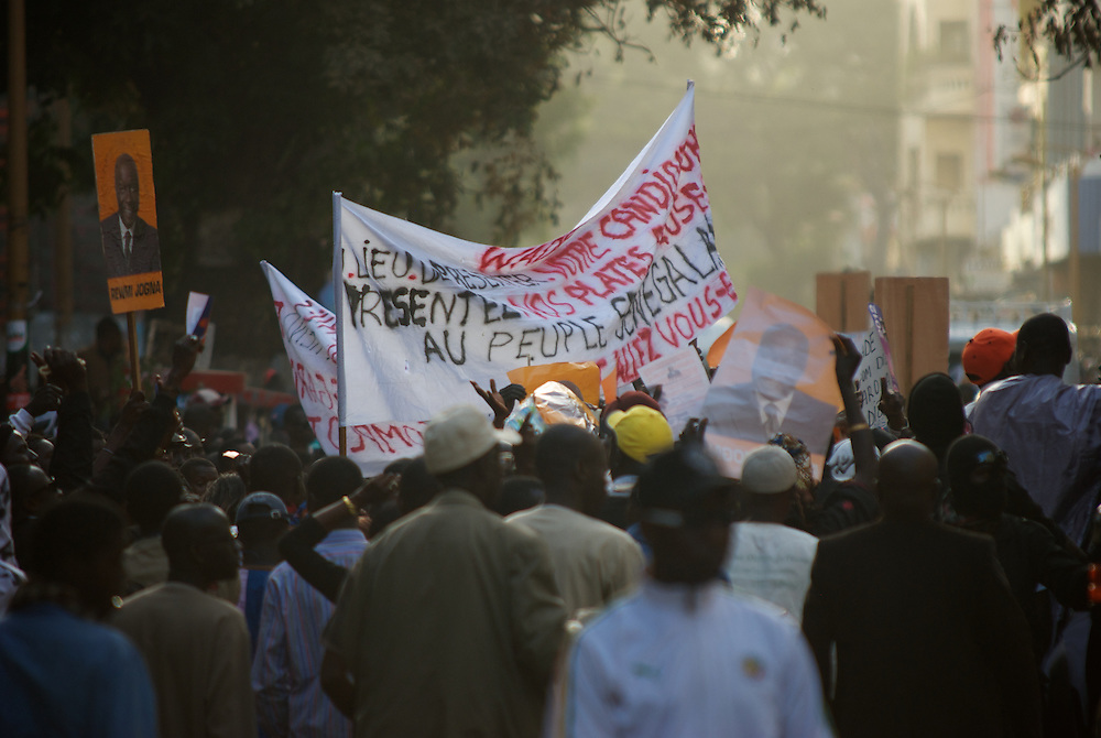 February 24, 2012 - Dakar, Senegal: Supporters of the presidential candidate Idrissa Seck rally in the last of day of electoral campaign in central Dakar. (Paulo Nunes dos Santos/Polaris)