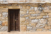 Dubai UAE Detail of stone huts on display at Heritage Village in Bur Dubai