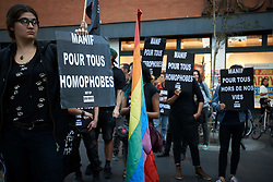 October 4, 2018 - Toulouse, France - People hold placards reading 'Manif pour tous: Homophobics'. The NGO Act'Up organized a die-in in Toulouse as a protest to the meeting of the far-right movement 'Manif pour tous' (ie 'demo for all') presided by Ludivine de la Rochère. The 'Manif pour Tous' has opposed to same-sex marriage and now opposes to ART and Surrogacy. Toulouse. France. October 4th 2018. (Credit Image: © Alain Pitton/NurPhoto/ZUMA Press)