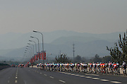 The peloton leaves Beijing behind and heads towards the mountains.  2011 Tour of Beijing Stage 2