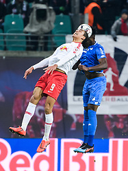 LEIPZIG, Feb. 26, 2019  Leipzig's Yussuf Poulsen (L) vies for a header with Hoffenheim's Kasim Adams during a German Bundesliga match between RB Leipzig and TSG 1899 Hoffenheim in Leipzig, Germany, on Feb. 25, 2019. The match ended in a 1-1 draw. (Credit Image: © Kevin Voigt/Xinhua via ZUMA Wire)