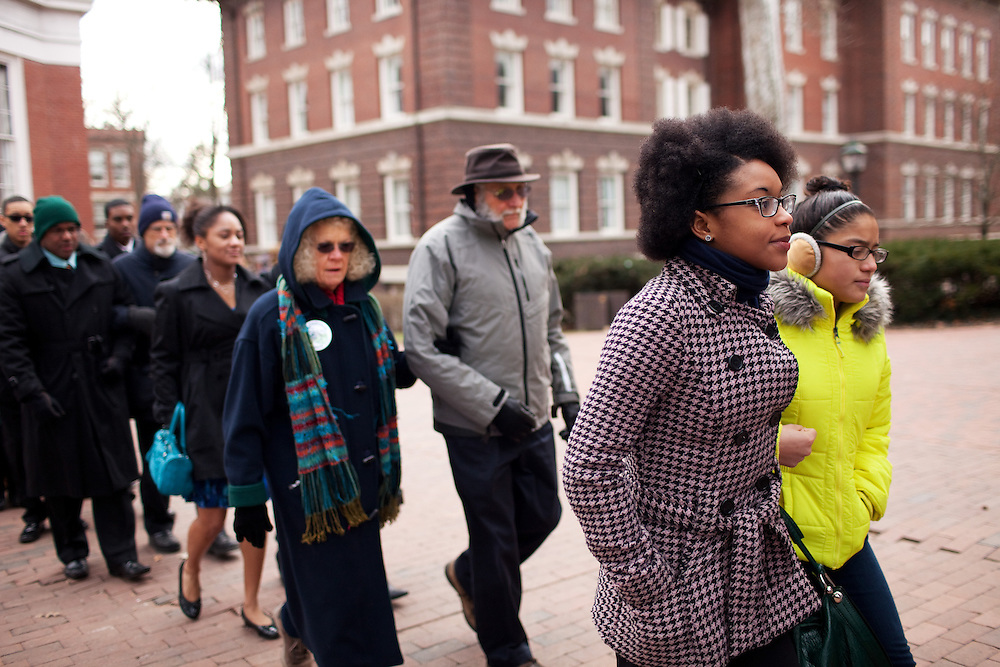 Alice Ragland takes part in the Martin Luther King Jr. Silent March outside the Galbreath Chapel at Ohio University in Athens, Ohio on Monday, January 21, 2013. Photo by Chris Franz