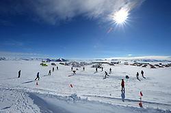 "© Licensed to London News Pictures. Union Glacier, Antarctica. Competitors from the Antarctic Ice Marathon play a game of impromptu ""Ashes"" cricket at the Union Glacier camp, Antarctica ahead of the 2013 Antarctic Ice Marathon, which takes place  just a few hundred miles from the South Pole at the foot of the Ellsworth Mountains.. The majority of players were either Australian and English. It was declared a sporting draw. Photo credit: Mike King/LNP"