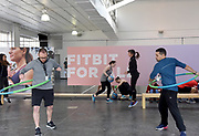 Media participate in #FitbitForAll workouts during the Fitbit launch event in New York, Monday, March 12, 2018. Fitbit unveiled its second smartwatch, Fitbit Versa, and first-ever device for kids, Fitbit Ace, along with the Fitbit family account and female health tracking, all continuing to support Fitbit's vision of making the world healthier, while reaching more people in unique ways to continue to help them achieve their health and fitness goals. (Photo by Diane Bondareff/AP Images for Fitbit)