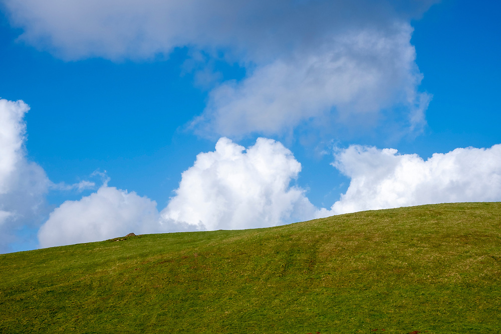 Big blue sky with fluffy white cirrus clouds above a steep inclining field on a hill farm Carreg Cennen Castle, Trapp, Brecon Beacons, Powys, UK.  (photo by Andrew Aitchison / In pictures via Getty Images)