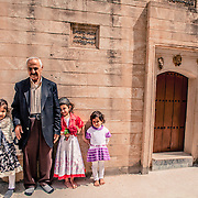 Yazidi family in Bahzani in front of one of the shrines in Bahzani