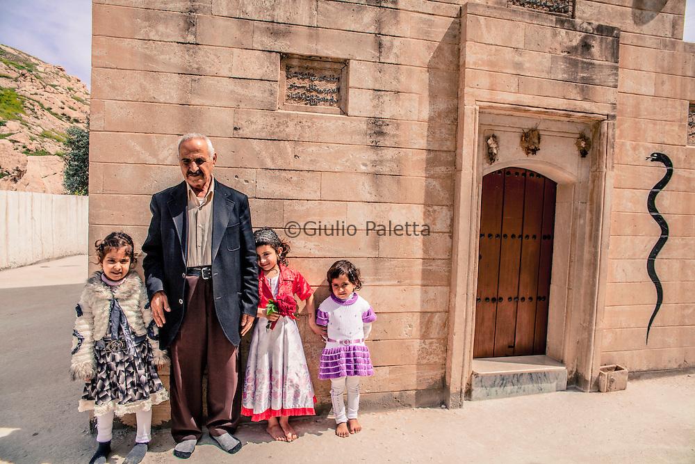 Yazidi family in Bahzani in front of one of the shrines in Bahzani