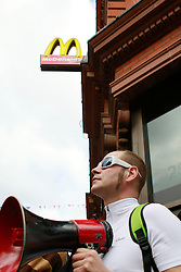 © Licensed to London News Pictures. 01/05/2012. London, UK. May Day protesters cause the closure of a McDonalds on Oxford after trying to get inside, calling for the end of mandatory non paid work placements. Photo credit : James Gourley/LNP