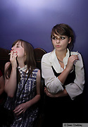 Two young girls smoking cigarettes, The Junk Club, Southend, UK 2006