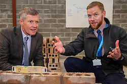 Pictured: Willie Rennie is shown the basics of bricklaying by Marc Felmming, Academic Quality Manager at Fife Coillege<br />
