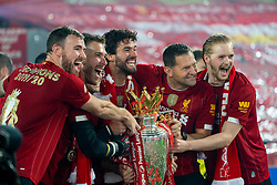 LIVERPOOL, ENGLAND - Wednesday, July 22, 2020: Liverpool's goalkeeper Andy Lonergan, goalkeeper Adrián San Miguel del Castillo, goalkeeper Alisson Becker, goalkeeping coach John Achterberg and goalkeeper Caoimhin Kelleher celebrate with the Premier League trophy as the Reds are crowned Champions after the FA Premier League match between Liverpool FC and Chelsea FC at Anfield. The game was played behind closed doors due to the UK government's social distancing laws during the Coronavirus COVID-19 Pandemic. Liverpool won 5-3. (Pic by David Rawcliffe/Propaganda)