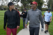 Justin Suh, who plays for the University of Southern California,  walks along with USC Athletic Director Lynn Swann while playing a round during the Collegiate Showcase at the Genesis Open at Riviera Country Club. The low scoring college player will get an exemption to play in the tournament that begins on Thursday. Los Angeles, CA 1/025/2018 (Photo by John McCoy)