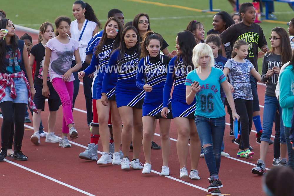 Middletown, New York - Middletown High School cheerleaders and other students dance on the track at Faller Stadium during Family Fun Night on May 17, 2013.