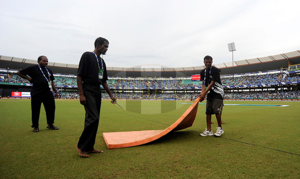 Grounds men are seen at work as the wet ground delays the start of the qualifier 1 match of the Oppo Champions League Twenty20 between the Northern Knights and the Southern Express held at the Chhattisgarh International Cricket Stadium, Raipur, India on the 13th September 2014<br /> <br /> Photo by:  Pal Pillai / Sportzpics/ CLT20<br /> <br /> <br /> Image use is subject to the terms and conditions as laid out by the BCCI/ CLT20.  The terms and conditions can be downloaded here:<br /> <br /> http://sportzpics.photoshelter.com/gallery/CLT20-Image-Terms-and-Conditions-2014/G0000IfNJn535VPU/C0000QhhKadWcjYs