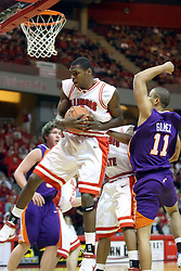 12 January 2008: Dinma Odiakosa takes possession on a rebound in front of Victor Gomez during a game in which  the Purple Aces of the University of Evansville lost to  the Redbirds of Illinois State on Doug Collins Court at Redbird Arena in Normal Illinois by a score of 74-66.